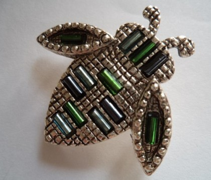 Beetle brooch. Interesting design with beads, made during the 1980-1985 period