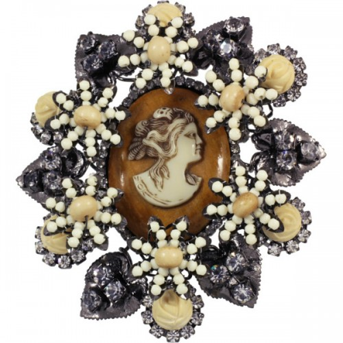 Vintage brooch with a large cameo surrounded by flowers