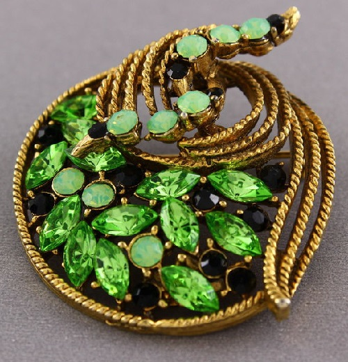 Vintage costume jewelry of peridot, rhinestones, marked Weiss