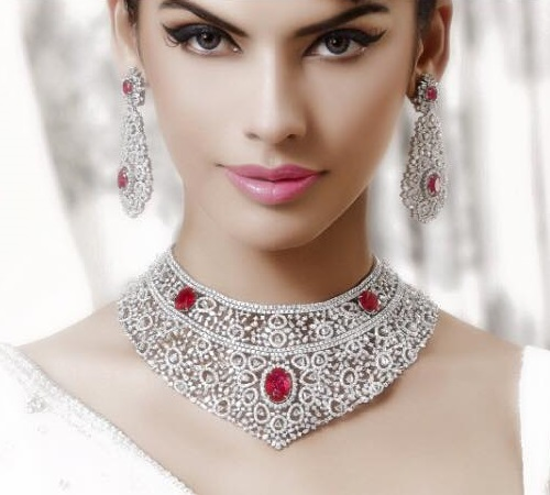 Beautiful model Gabriela Bertante wearing traditional Indian jewellery - large earrings and necklace