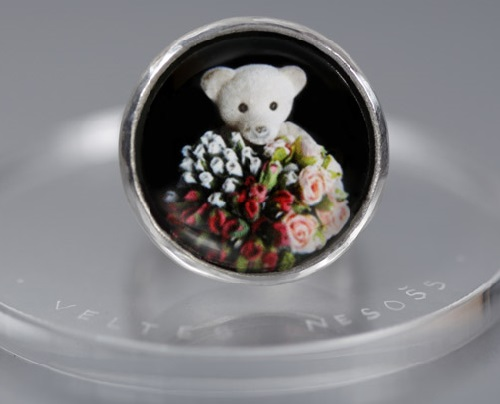 Bringing gifts. Teddy bear ring