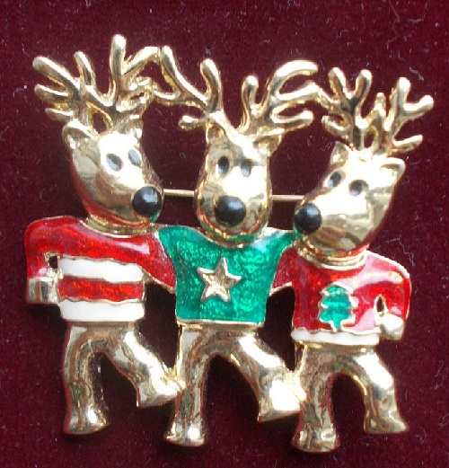 Festive and fun, and at the same time uplifting Christmas vintage brooch in the form of dancing for joy deer