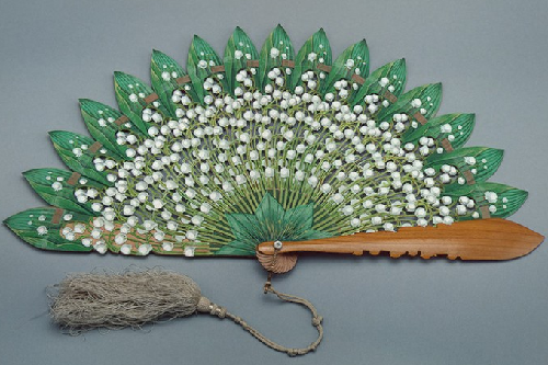 Folding Fan with plates in the shape of flowers and leaves of lily of the valley
