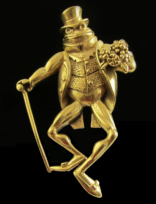 Funny brooch - a frog in a frock coat, waistcoat and top hat, and even with a bunch of flowers - obviously this is gentleman. Marked MFA
