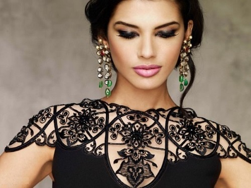 Gabriela Bertante wearing long earrings and lace in black tone
