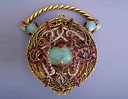 Iraj Moini round purse with scrolling metal openwork intertwined with cabochon pink tourmalines and rhinestone swirls, set to the center with large cabochon jade-green stones