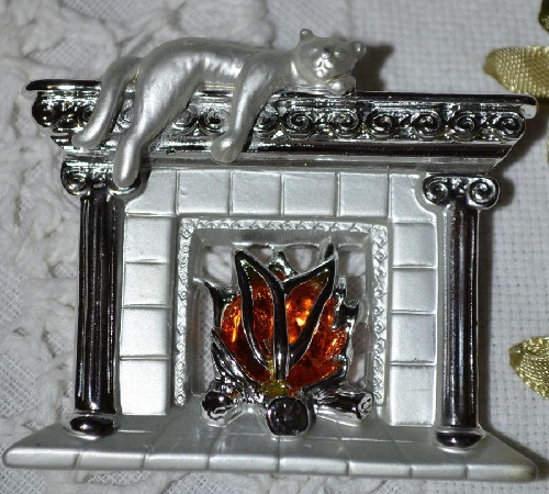 Vintage Brooch by AJC Cat on a fireplace