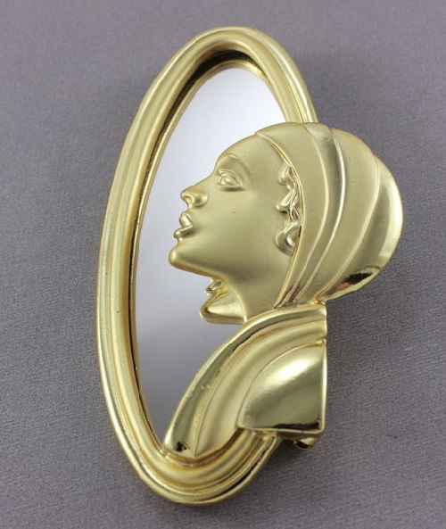 Vintage brooch 'Girl at the mirror' by Jewellery company AJC