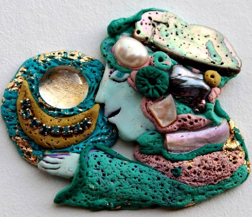 A grotesque brooch 'Girl with the Moon'