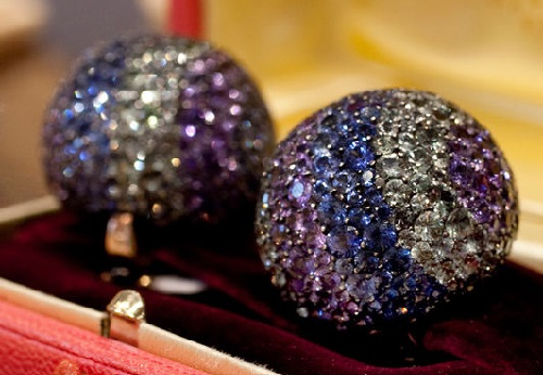 A pair of 'ball' clips with diamonds and colored sapphires from JAR