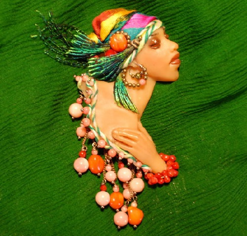 Alyona Abramova unique jewellery. African woman. Brooch manual molding with coral