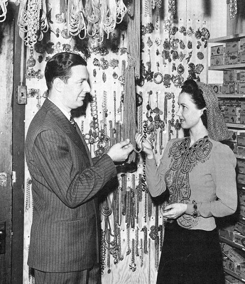 Joseff and actress Katherine Wilson viewing chains. Cigar boxes are the same
