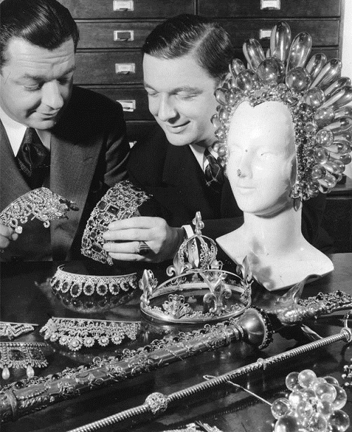 Joseff and his brother Jimmy Glaser are viewing their products. A huge headdress made of acrylic, Virginia Bruce wore in the movie The Great Ziegfeld