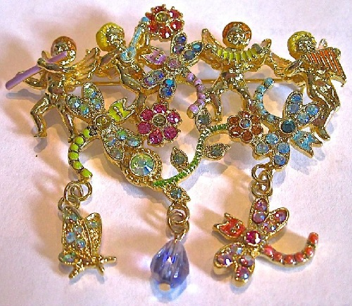 Kirks folly brooch Angels dancing with dragonflies