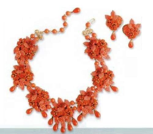 Necklace and earrings. artificial coral cabochons mounted in gilded metal filigree. 1980s. £ 500-600 CRIS