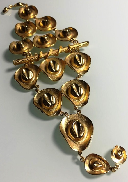 The extraordinary vintage shoulder brooch with cowboy hats, marked Ultra Craft, 1980s