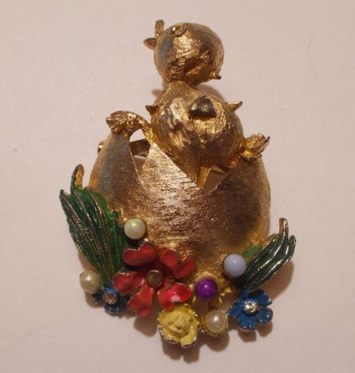 A chick breaking free from the eggshell.Rare collectible brooch of 1960s, England