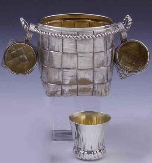 "A four-piece silver parcel-gilt trompe l'oeil vodka set. Stamped with city hallmark, assayer's mark ""IE"" and master's mark ""NJa"" in Cyrillic (N.D. Yanichkin) and 84 standard. St. Petersburg"