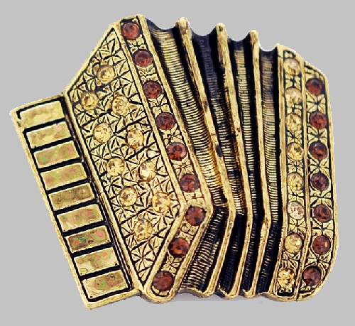 Accordion Brooch of brass and Topaz