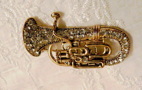Alto horn Vintage Brooch 1980s, jewelry made of alloy gold color. The entire surface of the instrument encrusted with crystals