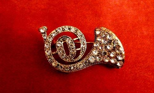 Alto horn Vintage Brooch 1980s, made of alloy encrusted with crystals