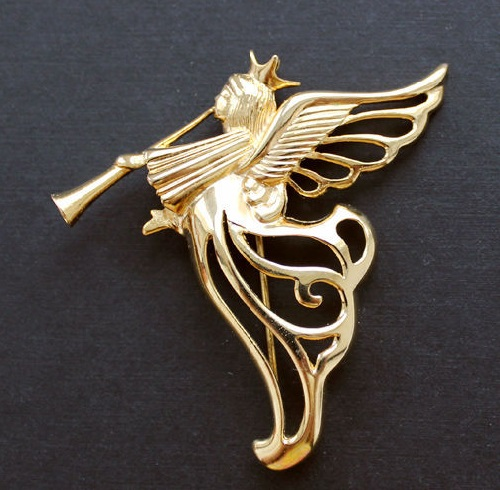 Angel playing the trumpet. Givenchy brooch of 1980s