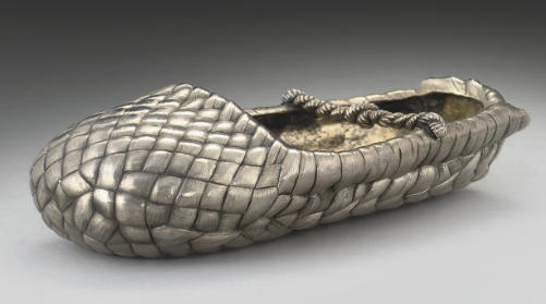 Ash tray. A 19th century Russian Silver Trompe-l'oeil Ash tray in the form of a bast shoe. Mark of Ivan Chlebnikov, St. Petersburg, 1878.