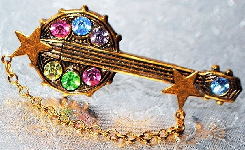 Banana bob brooch of 1970-80s Disco-music inspired, Swarovski crystals