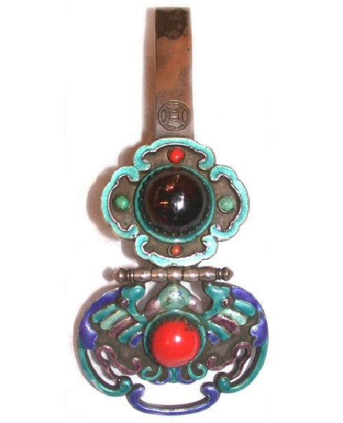 Belt hook with enameling , and inlaid stones. Mongolia late 19th century