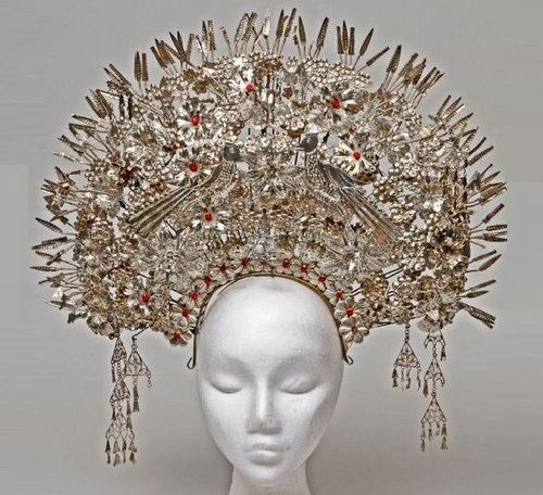 Bridal Headdress worn at the wedding of Minangkabau people. It's made of filigree silver, sheet foil, beads, and crafted with cut-out love birds