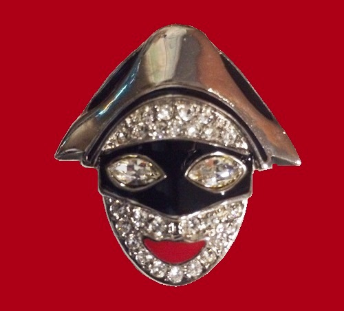 Butler and Wilson jewellery. Brooch Harlequin made of an alloy of silver, encrusted with clear rhinestones, eyes of crystal, Lips and a mask covered with colored enamel. Marked B & B