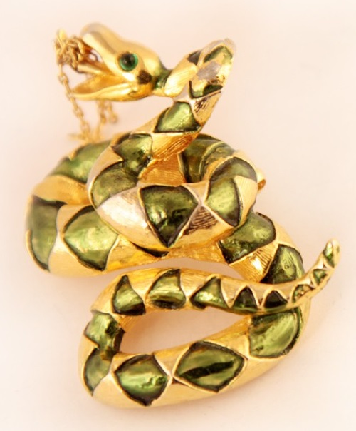 Brooch-pendant in the form of a snake made of metal color yellow gold and decorated with light green enamel. Snake Eyes - green cabochons
