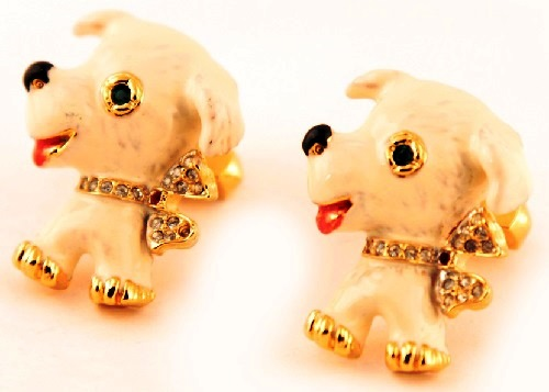 Cute cuff-links in the form puppies