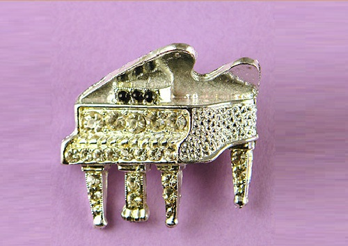 Cute vintage brooch alloy coated in platinum. Stylized piano decorated with transparent crystals and three black beads. The brooch is not marked, 1950-60-ies., USA