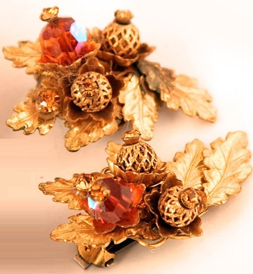 Elegant clips of Russian gold-colored metal, attached to the filigree basis beads, crystals, metal leaves. Eugene costume jewelry