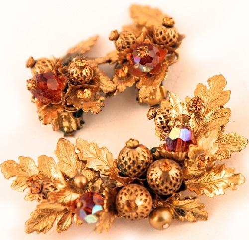 Elegant set of brooch and clips of Russian gold-colored metal, attached to the filigree basis beads, crystals, metal leaves. Eugene costume jewelry