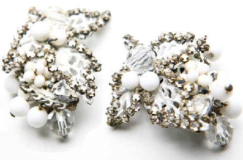 Fine white clips with enamel, crystals and beads, 1950s. Eugene costume jewelry