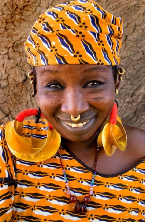 Fulani are known for their striking clothes, their ponderous gold decorations