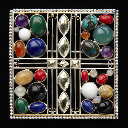 Josef Hoffmann Art Deco brooch designed in 1908. 14 karat gold and sterling silver set with agate, lapis lazuli, malachite, opal, tiger's eye, labradorite, carnelian, jasper, and citrine