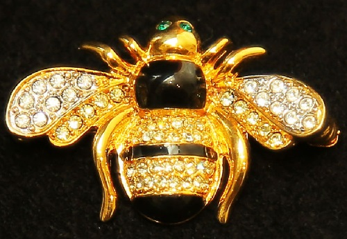 Luxury brooch in the shape of a bee, decorated with crystals of white and green and black enamel, gold-plated. 1998