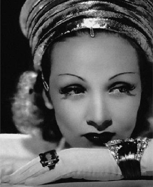Marlene Dietrich wearing Verdura jewellery - diamond, platinum and gold 'Lily' bracelet. Verdura high jewellery