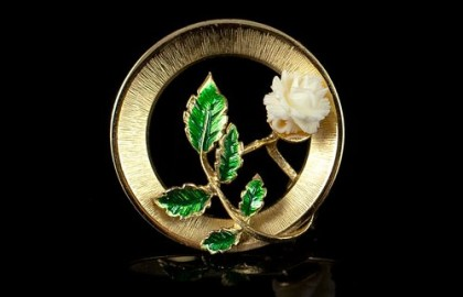 Gold-plated miniature silver brooch with a rose of ivory, carved by hand, and gentle enamel on succulent leaves
