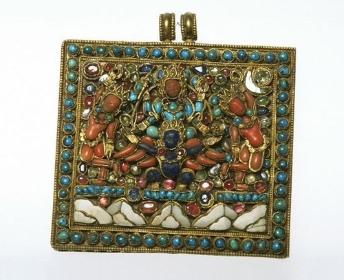 Pendant with inlaid precious and semi precious stones