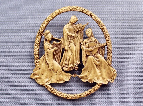 Playing musical instruments medieval ladies - harp, lute, violin. MFA brooch