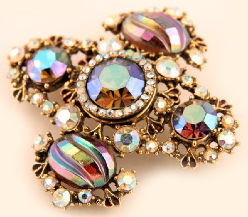 Stylish brooch resembling the Maltese cross, made of rhinestones brown and clear crystals. Marked Har