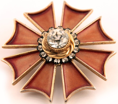 Stylish brooch resembling the Maltese cross, made of rose gold color metal and enamel decorated with brown and clear crystals. Marked Har