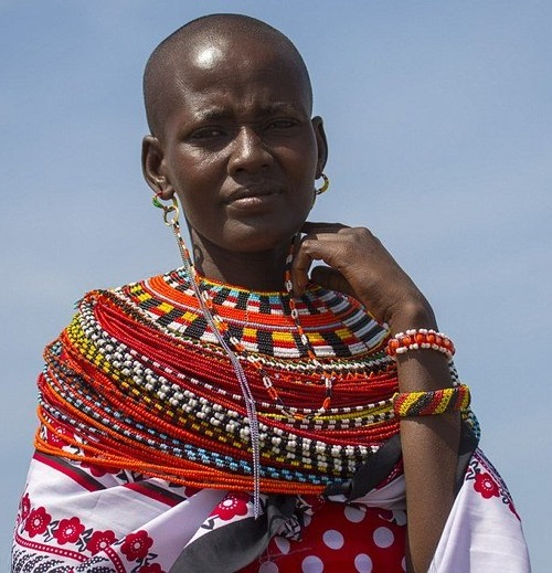 The woman wears a special earring on her left ear to show she has already 2 or 3 of her sons being circumcised