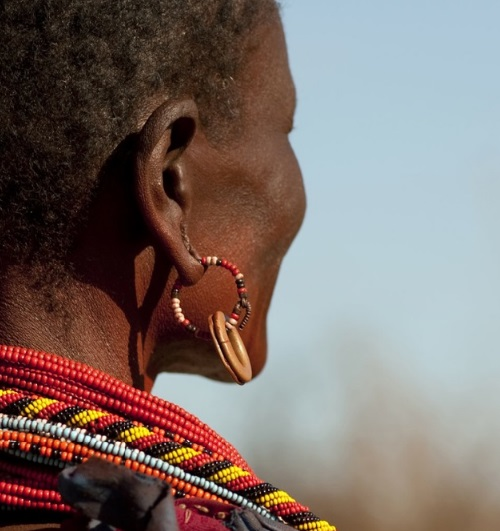 The woman wears brass earrings to show she is married