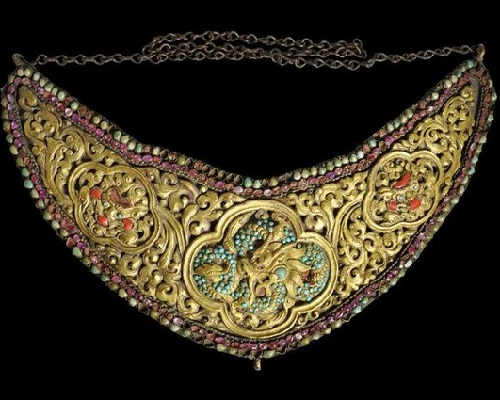 Turquoise and ruby gem set gilded copper breast plate