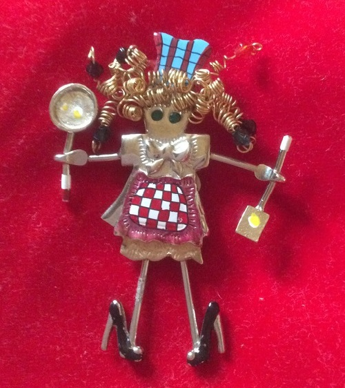 Vintage brooch Housewife by the jewellery company GANZ. Large brooch with moving spoon legs in high heels